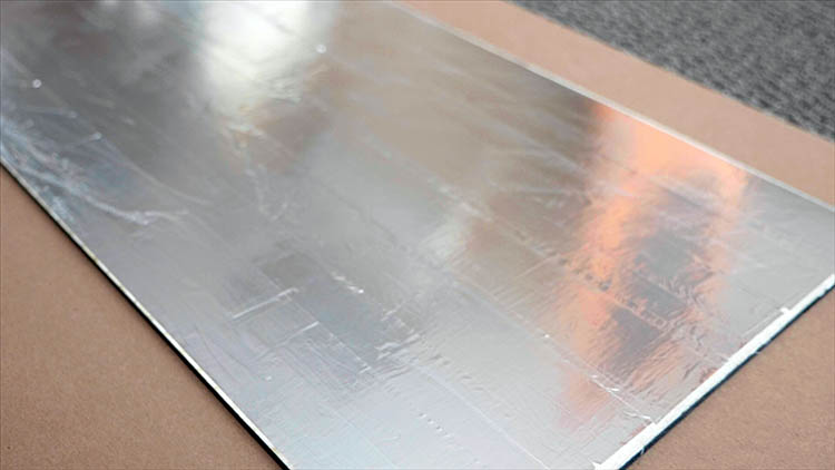 The back plywood panel covered in foil tape.