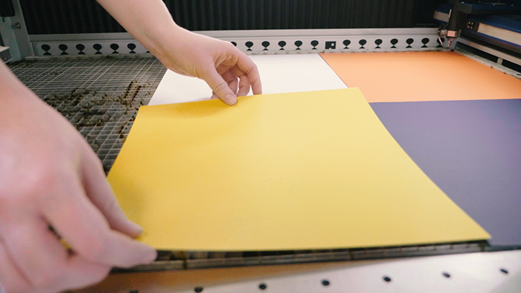 Placing cardstock paper in laser machine
